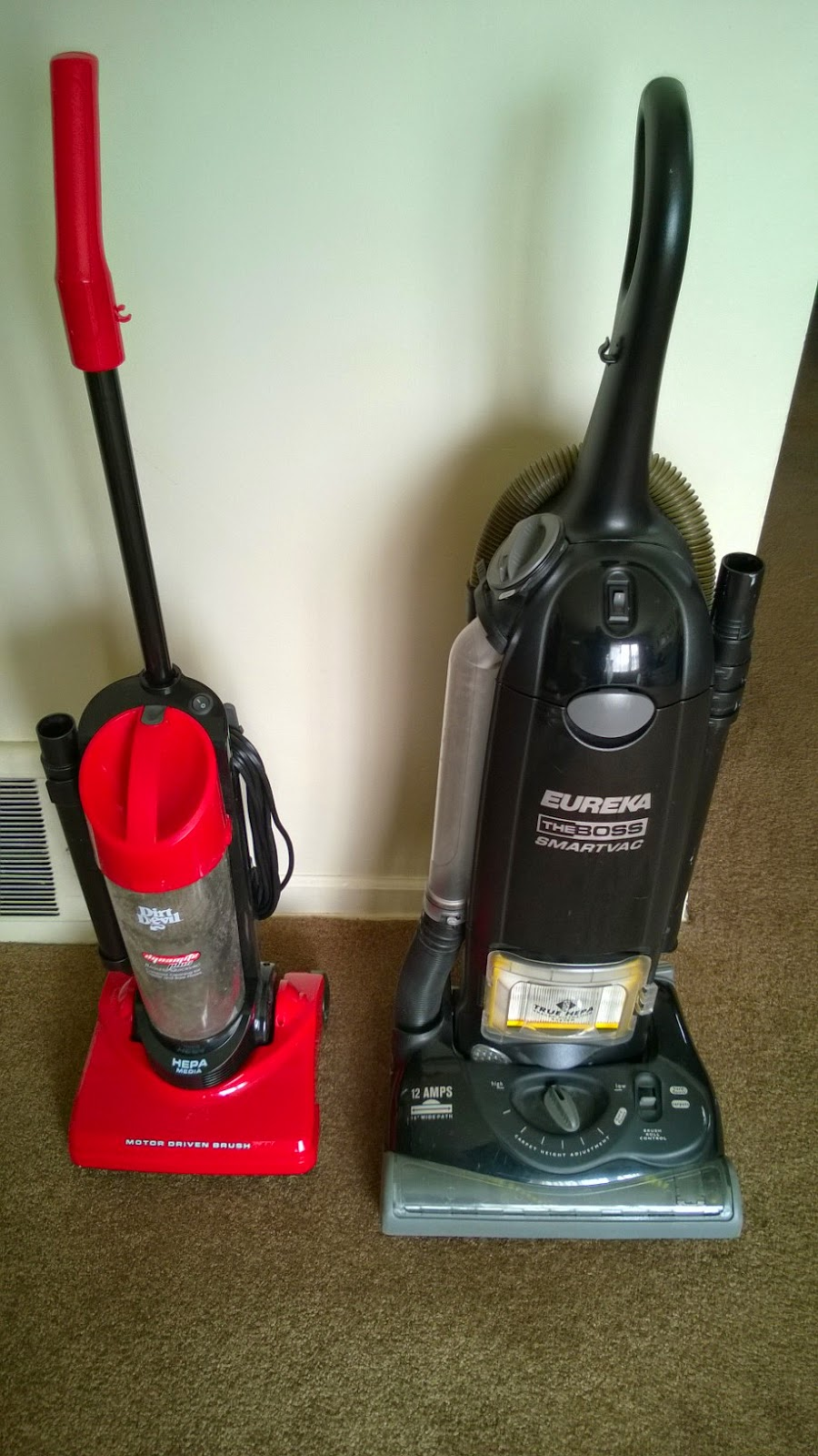 2 vacuum cleaners, small and large