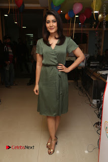 Actress Raashi Khanna Stills in Green Short Dress at Mirchi 95 Suno Aur Mercedes Jeeto Contest  0154.JPG