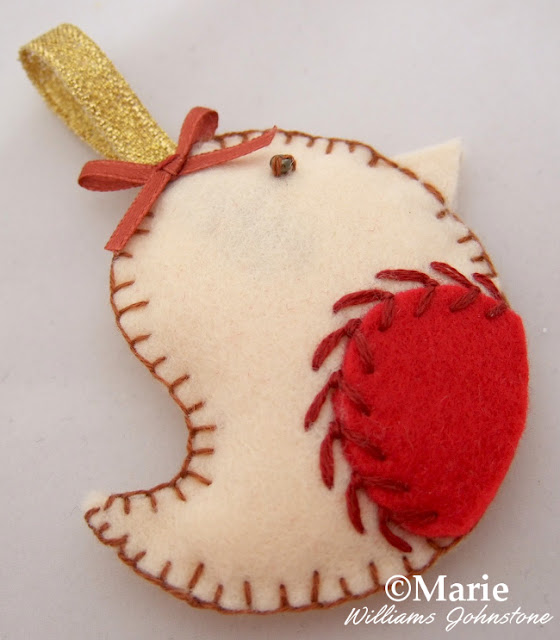 Make a hanging bird ornament for the tree from felt and ribbon