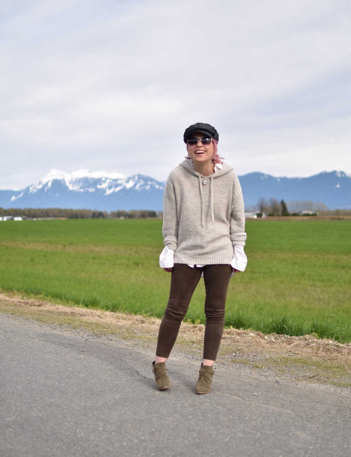 Monika Faulkner outfit inspiration - styling vegan suede leggings with ankle boots, a hoodie sweater, and a baker boy hat