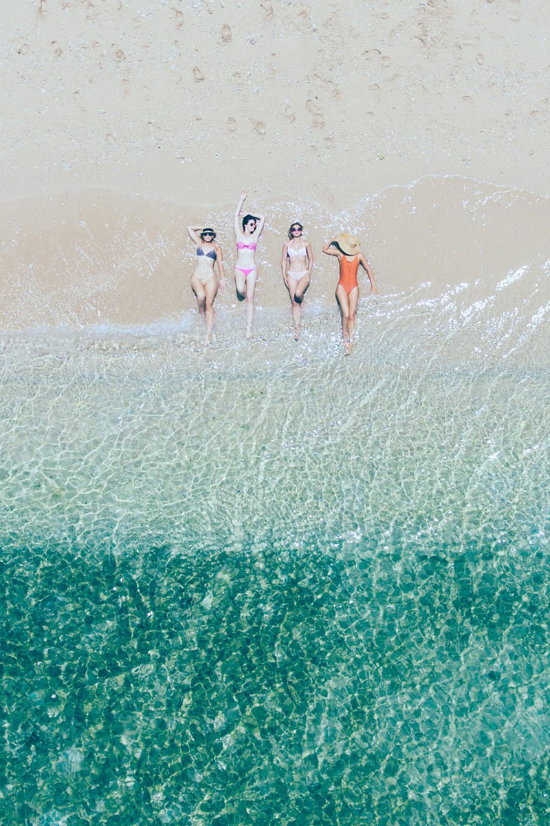 drone shot of girls in beach and tropical ocean frankland islands tropical north queensland