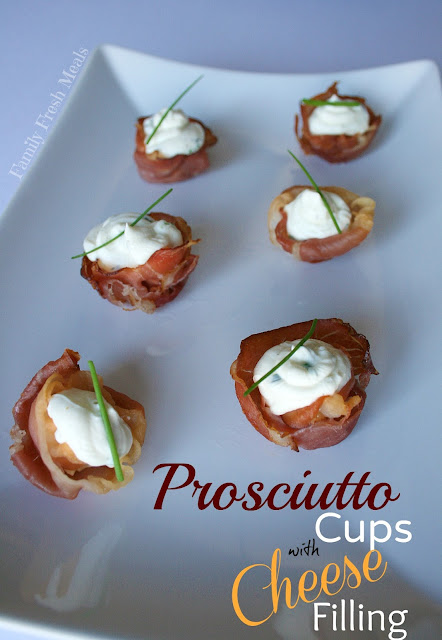 prosciutto cups with cheese herb filling served on a white plate