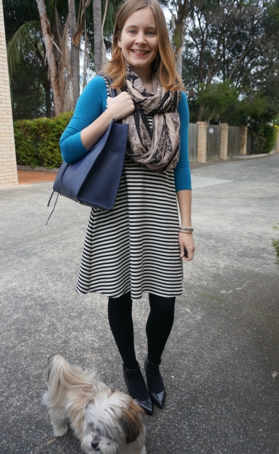 winter black white striped fit and flare dress layered with bright blue tee office wear