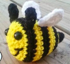 http://www.craftsy.com/pattern/crocheting/toy/free-baby-bumblebee-amigurumi/97943