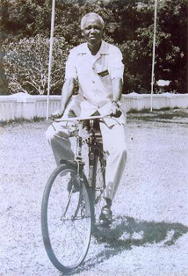 Mwalimu Nyerere rides a bicycle