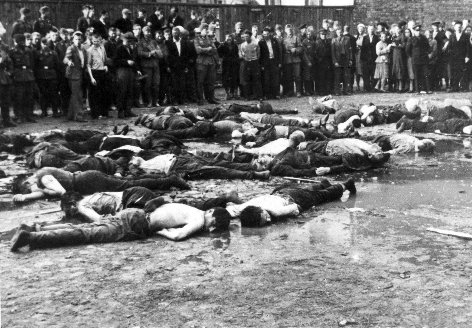 Crowd views the aftermath of a massacre at Lietukis Garage, where pro-German Lithuanian nationalists killed more than 40-60 Jewish men.