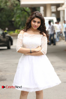 Actress Tejaswini Pictures in White Dress at Lachhi Teaser Launch  0032.JPG