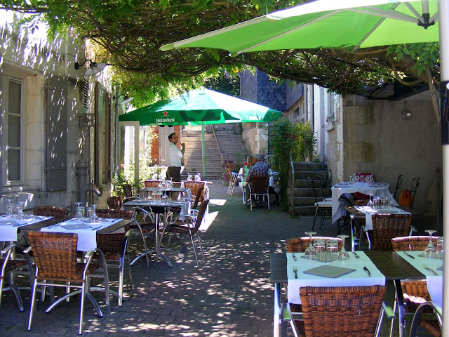 Restaurant terrace.  Indre et Loire, France. Photographed by Susan Walter. Tour the Loire Valley with a classic car and a private guide.