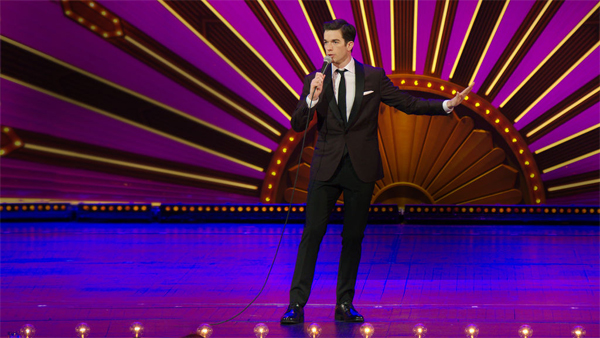 image of John Mulaney onstage at Radio City Music Hall during his latest stand-up special, 'Kid Gorgeous'