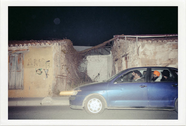 dirty photos - umbra - a night street photo of INDIAN SKHS IN A CAR