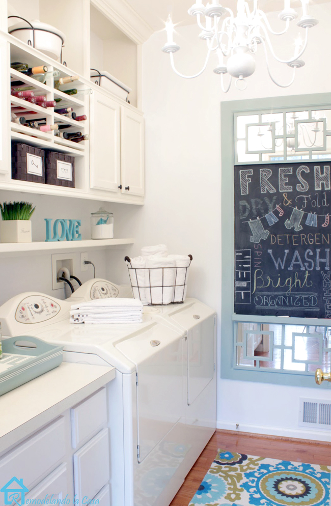 laundry room makeover with cabinets built up to the ceiling