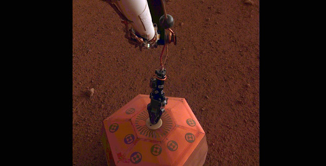 NASA's InSight lander placed its seismometer on Mars on Dec. 19, 2018. This was the first time a seismometer had ever been placed onto the surface of another planet. Image Credit: NASA/JPL-Caltech