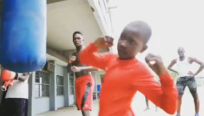 Israel Adesanya ‏Teaches Little Boy How To Throw Kicks During Visit To Nigeria After 16 years