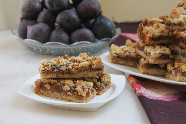 Food Lust People Love: Sticky, chewy, fig pecan bars are the perfect treat with a cup of tea or an ice-cold glass of milk. Baked up in a large pan, this recipe makes enough to share, but they also freeze beautifully so you don't have to. Use your favorite preserves or jam if you don't have fig.