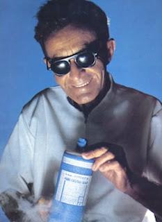 Dr. Emanuel Bronner holding a bottle of his soap