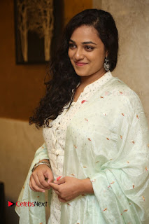 Actress Nithya Menen Latest Pictures in White Dress at 100 Days of Love Movie Audio Launch  0045.JPG