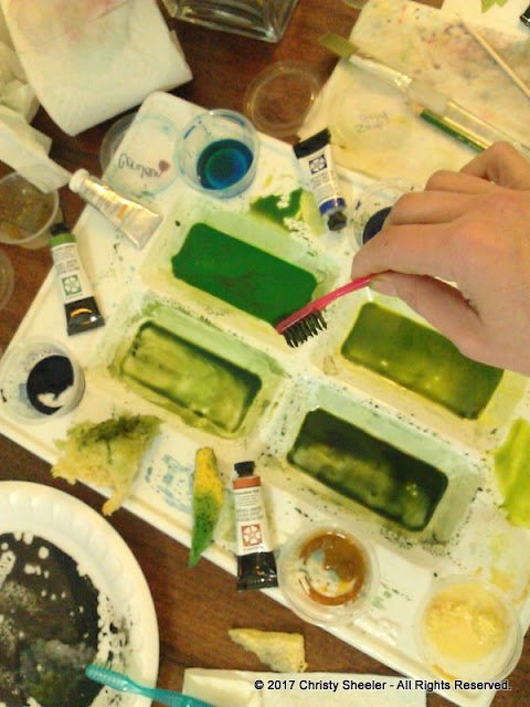 The palette, tubes of pigment, and a toothbrush for spatter.