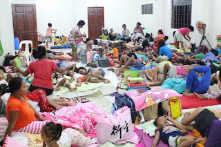 THOUSANDS FLEE PHILIPPINES AS GIANT TYPHOON MANGHKUT CLOSES IN