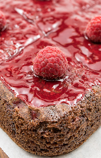 Vegan choco banana cake with raspberry close up