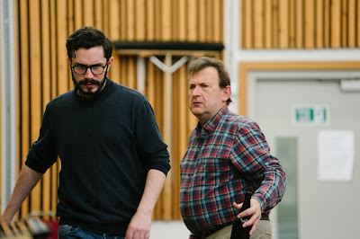 Rehearsals for Opera North's production of Put's Silent Night, November 2018 - Alex Banfield as Jonathan Dale and Adrian Clarke as Father Palmer - Photo Tom Arber