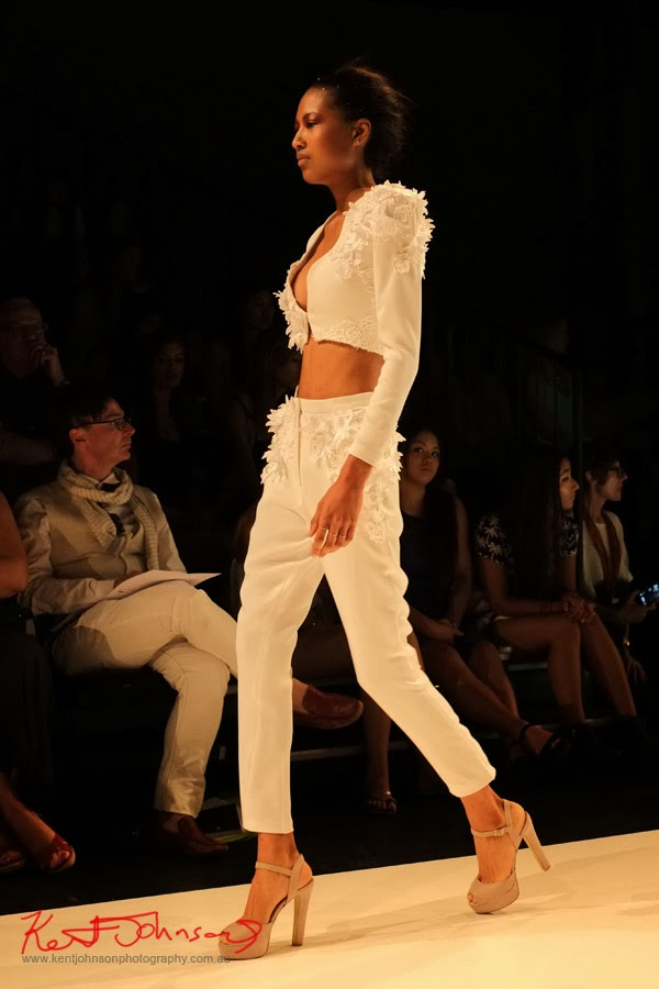 Sharon Widjaja; elegant white pants and jacket, no blouse -  New Byzantium : Raffles Graduate Fashion Parade 2013 - Photography by Kent Johnson.