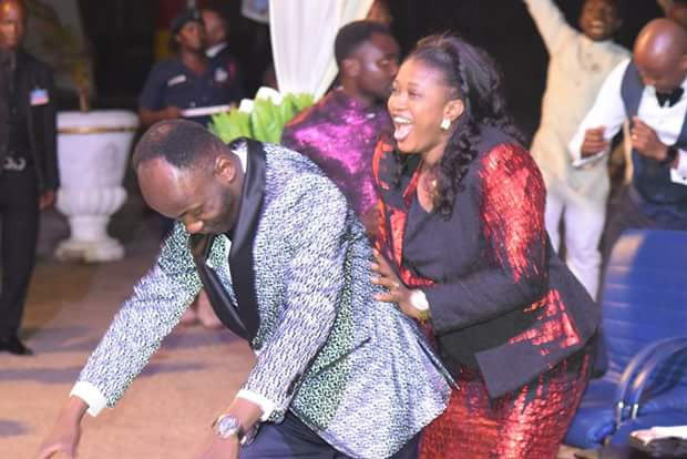 Apostle Suleman plays/dances with wife during service in Ghana