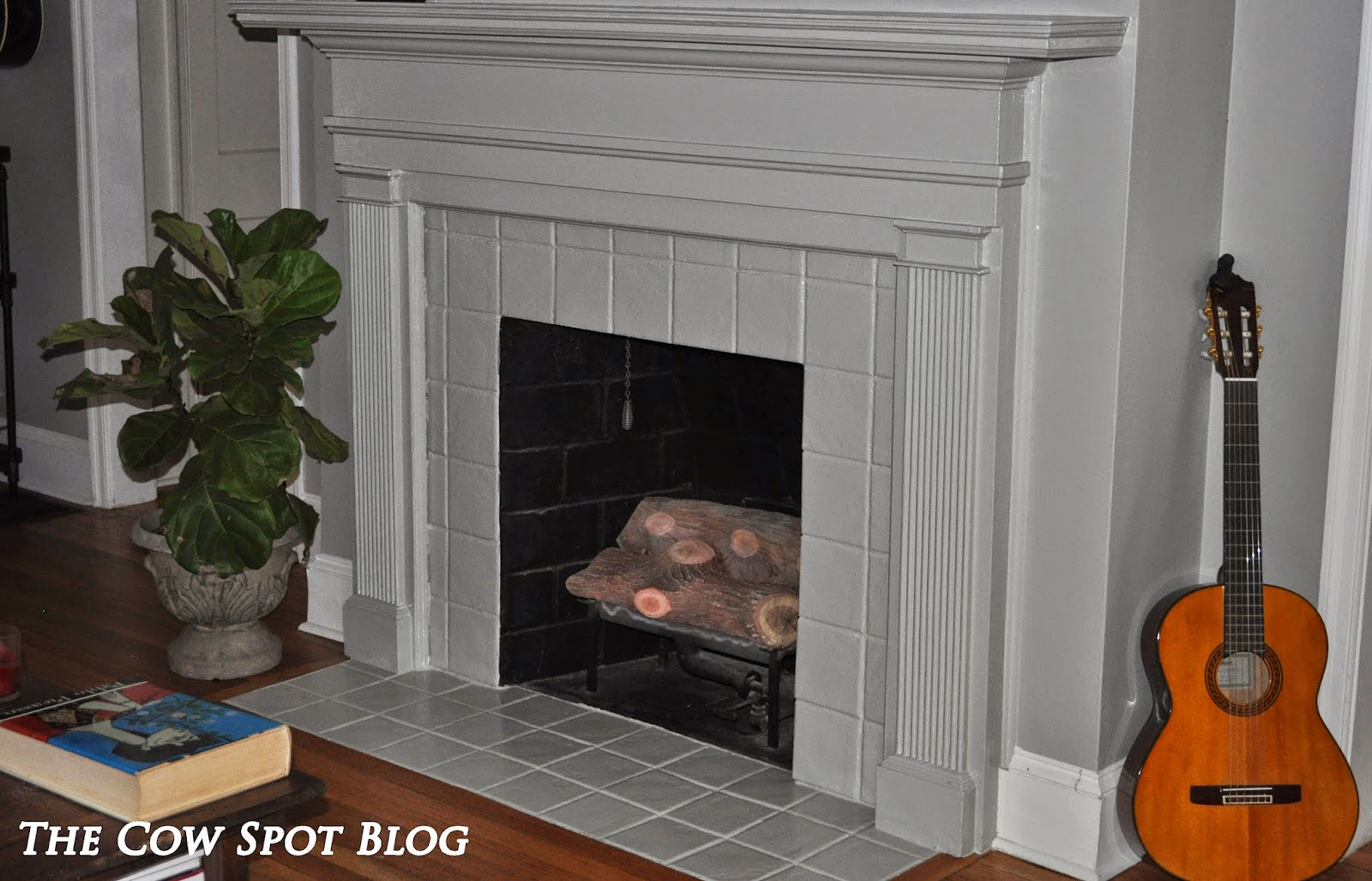 the cow spot fireplace refresh
