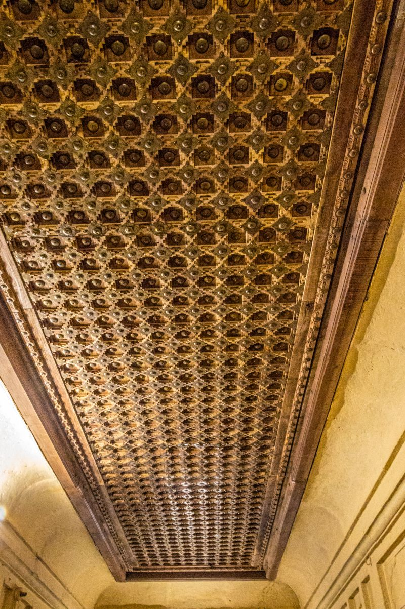 Ornately carved wooden ceiling