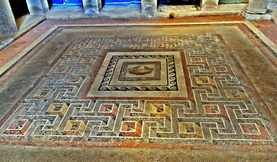 Roman Floor mosaic with central emblema showing doves drinking out of a cup and a Dramatic Svastiska border.