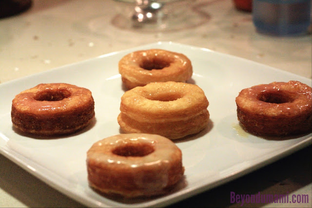Five Cronuts laid out.At center: NQN's cronut, Left,Bottom,Right: DWJ Cronut, Top:Pilllsbury