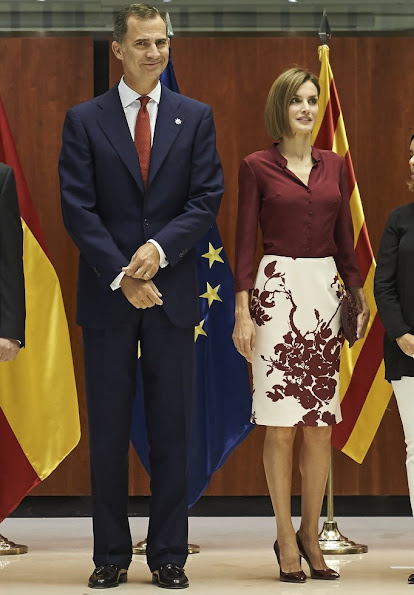 Queen Letizia attended an official lunch for Constitutional Tribunal. Felipe Varela satin blouse and floral skirt