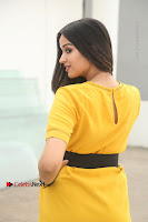 Actress Poojitha Stills in Yellow Short Dress at Darshakudu Movie Teaser Launch .COM 0303.JPG