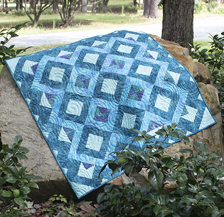 Vortex Mosaic Throw Quilt by Marjorie Busby of b-Quilts, The Free Pattern designed by Accuquilt.
