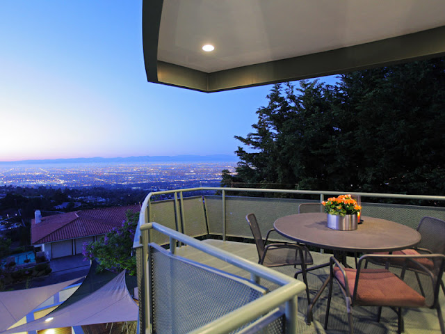 Photo of Los Angeles as seen from the small balcony with round table