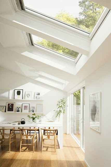 Roof window skylights over a dining room