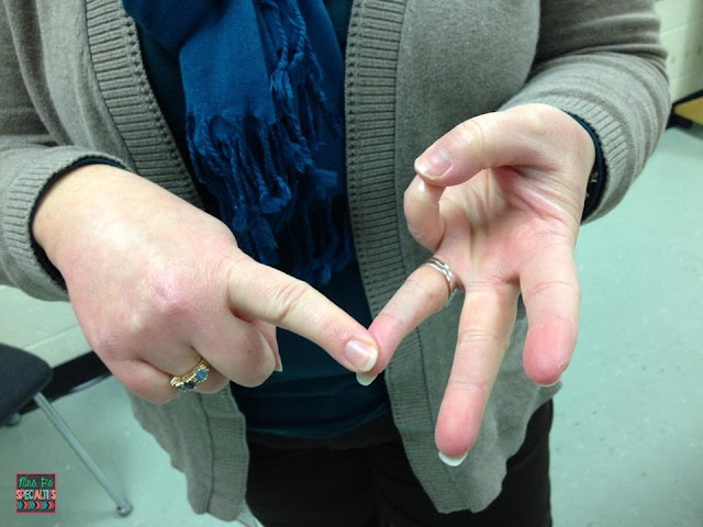 photo of teacher touching 3 fingers