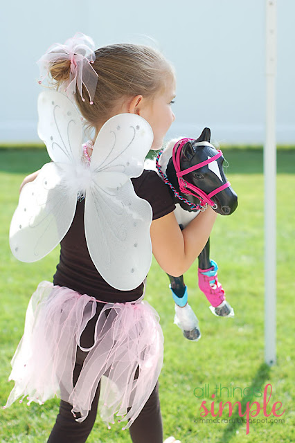 Start your fairy party by adorning each attendee with fairy wings and skirts, hair accessories, and glitter make-up.