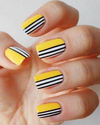diseño de uñas amarillas con rayas