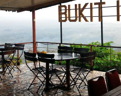 Tinuku Bukit Indah Restaurant & Hotel stylish mosaic tile floor to dramatize romantic panoramic city night