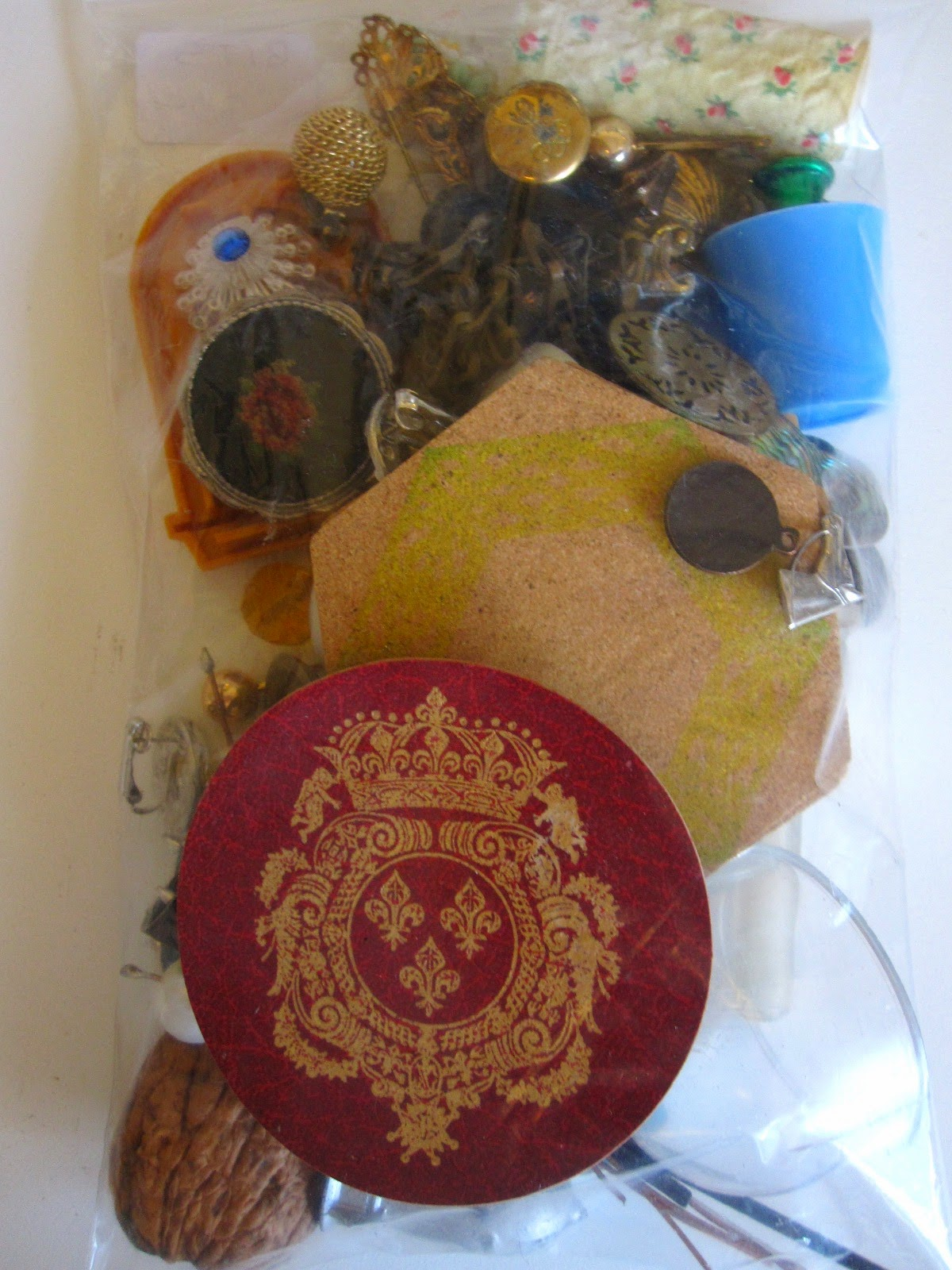 Back of A5-sized bag of bits and bobs for miniature use. Several vintage full-sized coasters are shown, including three octagonal cork coasters.