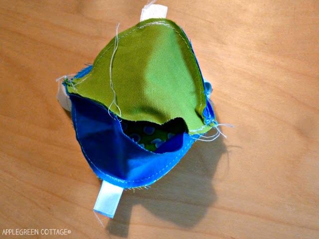sewing blue and green fabric ball