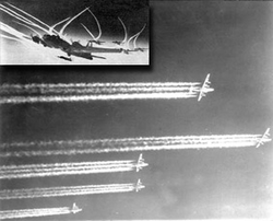 Aircraft dropping lines in sky