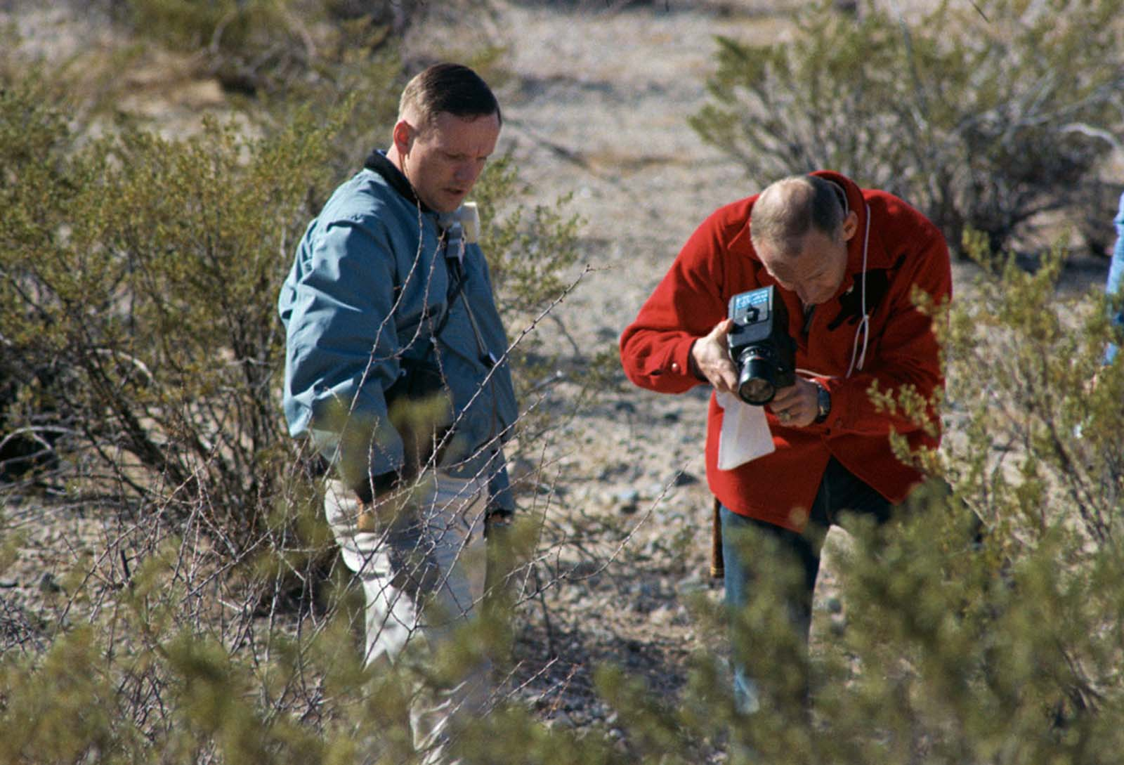 The astronauts Neil Armstrong and Buzz Aldrin take part in a geology field trip in Sierra Blanca, Texas.