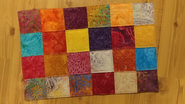 Kennel quilt made with Island Batik Boho fabrics