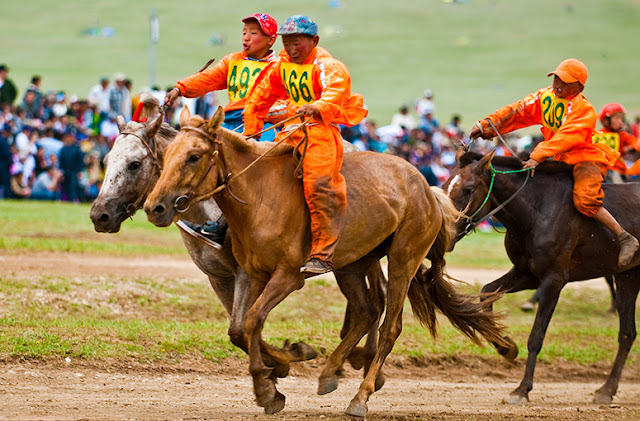 Participants of the five year old horse (Soyolon) race approaching the finishing line, Naadam, Mongolia