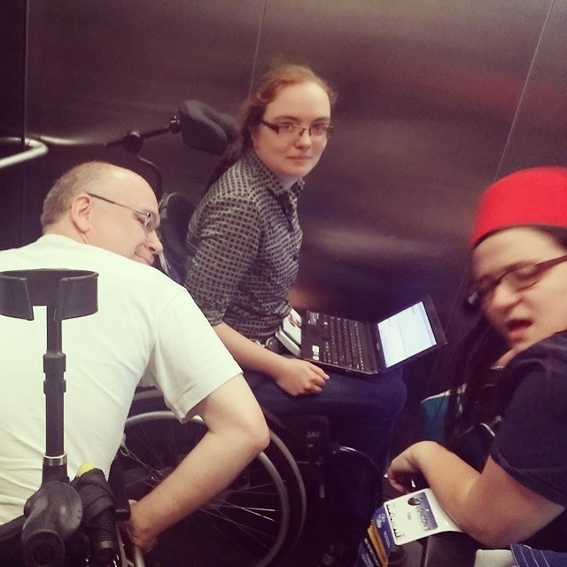 Three wheelchair users in one elevator, author on left, Kaberett at back, Trialia to right