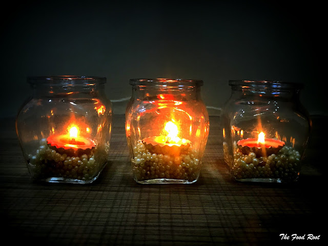 Mason Jar with embellishments and an LED tea light inside them.