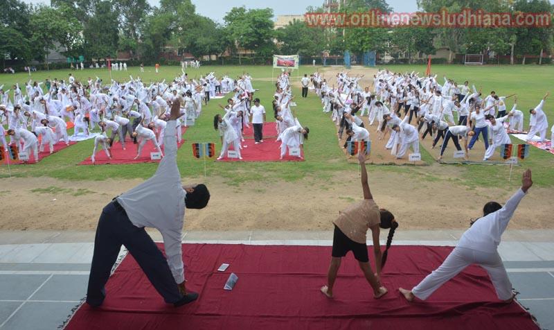 Students doing Yoga during International Yoga Day Celebration at KCW