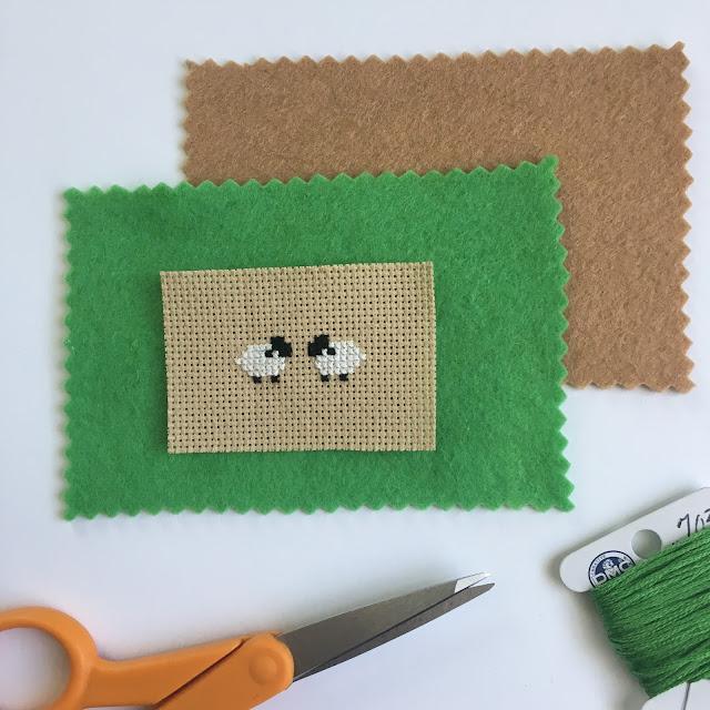 cutting felt for cross-stitched pincushion