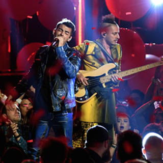 Joe Jonas band DNCE perform at the 2016 Billboard Music Awards. Watch now at JasonSantoro.com